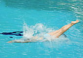 Woman diving into pool