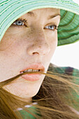 Young woman wearing sun hat, close-up