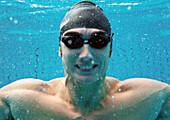 Man smiling underwater, underwater view.