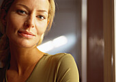Woman looking at camera, close-up, portrait.