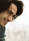 Man smiling, profile