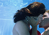 Couple kissing underwater, close-up