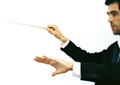 Orchestra conductor, side view