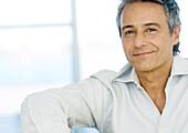 Mid-adult man smiling, portrait