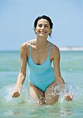 Woman splashing in water