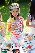 Girl in costume at outdoor birthday party