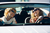 Mother and adult daughter out together in car