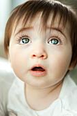 Infant looking up, portrait