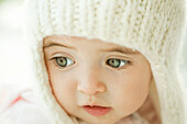 Baby girl wearing knit hat, portrait