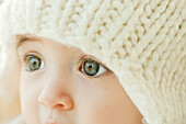 Baby wearing knit hat, close-up