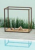 Woman wearing bikini, lying on back in square structure between lake and pool