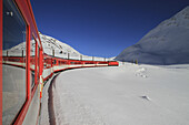 A train traveling through Oberalp Pass, Andermatt, Uri Canton, Switzerland