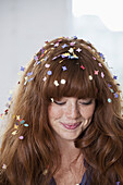 A young woman with confetti in her hair