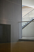 Corridor, floor and wall viewed through window, making geometric shapes