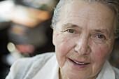 A cheerful senior woman, close-up