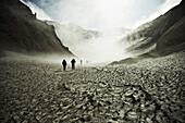 Hikers trekking through the Mutnovsky Volcano, Kamchatka, Russia
