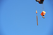 Crane hook against a clear blue sky