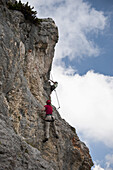 Two people climbing rock face at The Wetterstein, Tirol, Austria