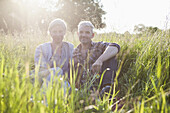 Portrait of smiling mature couple taking break from gardening