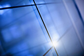 Abstract intersecting lines on a glass surface