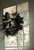 Leaf wreath on wall