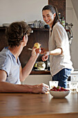 Young couple in kitchen preparing breakfast