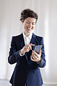 Attractive Businesswoman Holding Virtual Smart Phone