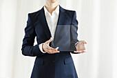Businesswoman Showing Blank Transparent Electronic Digital Tablet