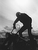 A man standing on a motorcycle