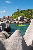 Sea kayak tour with catamaran as basecamp on Seychelles, Indian Ocean