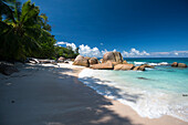 Sandy beach with palm trees, Sea kayak tour with catamaran as basecamp on the Seychelles, Indian Ocean