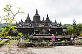 Female tourist visiting Brahma Vihara Arama, Banjar Tegeha, Buleleng, Bali, Indonesia