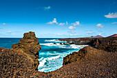 Black lava cliffs near Los Hervideros, Lanzarote, Canary Islands, Spain