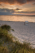 Beach chair on the beach at sunset, Stein, Laboe, Kiel Fjord, Baltic Sea, Friedrichsort, Kiel, Schleswig-Holstein, Germany
