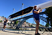 Men carrying a rowing boat, At the Ponte Luis over Rio Douro, Porto, Portugal