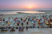 People on the beach promenade watching the sunset, Borkum, Ostfriesland, Lower Saxony, Germany