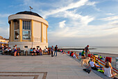 People on the beach promenade in front of the Pavilion, Borkum, Ostfriesland, Lower Saxony, Germany