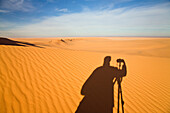 Shadow of a photographer in the libyan desert, Libya, Sahara, North Africa
