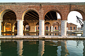 colonnades, Venetian Arsenal, historic, military, industrial shipbuilding quarter of Venice, docks, Lagoon, Venice, Italy