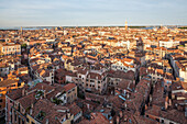 view over the roofs of Venice, from campanile of Frari church, tower shadow, Venice, Italy