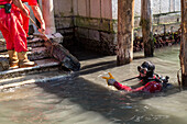 industrial underwater workers, IDRA, inspect damage caused by motorised boat traffic in the canals, Venice, Italy