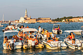 Festa del Redentore, Redentore Feast Day, thanks that the plague ended, party boats anchored, Giudecca, sunset, 3rd Sunday of July, San Giorgio Maggiore in background, Venice, Italy
