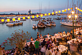 Festa del Redentore, Redentore Feast Day, thanks that the plague ended, pontoon bridge built across Giudecca Canal annually, sunset, summer evening, 3rd Sunday of July, boats, party, lanterns, banquet tables, Venice, Italy