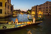 Viva Voga Veneta, association for rowing revival, traditional rowing boat, womens rowing club, rowing sport, evening light, lanterns, theatre and culture event on the canals, Venice, Veneto, Italy
