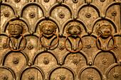 detail of lion's heads on main bronze doors Saint Mark's Basilica, decorative, symbols, animals, Venice Italy