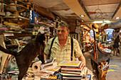 Luigi Frizzo, bookshop  Libreria Acqua Alta, piles of books, cat, gondola, Venice, Italy