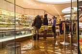Acqua Alta, high water, indoors, Espresso bar, coffee in rubber boots, Venice, Italy