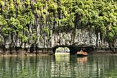 exploring a hidden lagoon by raft in Halong Bay, Vietnam.