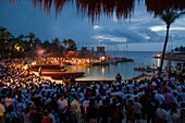 The parting of the canoes of the Sacred Mayan Crossing is performed in ancient Mayan port of Pole, today Xcaret. The ceremony takes place in the dawn and bring together lots of people, wishing luck to the rowers heading to the island of Cozumel.