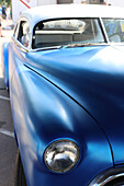 A 1942 Ford coupe automobile car with a custom blue paint job